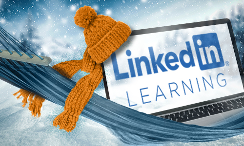 laptop with scarf and hat in the snow on a hammock
